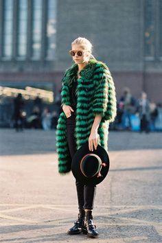 Shop this look on Lookastic:  https://lookastic.com/women/looks/fur-coat-crew-neck-t-shirt-skinny-jeans/15352  — Dark Green Fur Coat  — Black Crew-neck T-shirt  — Black Skinny Jeans  — Dark Green Wool Hat  — Black Leather Boots