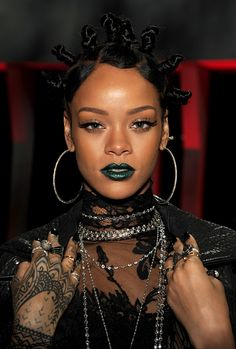 Rihanna makes green lipstick look so good! She wore this bold shade at the 2014 iHeartRadio Music Awards.