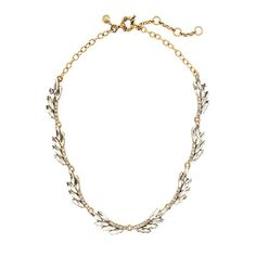 """This pretty necklace is finished with crystal clusters arranged like long graceful feathers. It's the kind of not-<i>too</i>-sparkly accent we've been wanting to try with a crisp collared shirt. <ul><li>Length: 16"""" with a 2 1/4"""" extender chain for adjustable length.</li><li>Zinc, brass, glass.</li><li>Light gold ox plating.</li><li>Import.</li></ul>"""