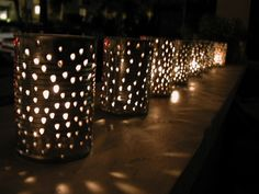 Tin Can Lanterns for table centerpieces. Cheap, recycled, and easy enough to make. Throw a little heat-proof spray paint and ribbons on them to add a little color.
