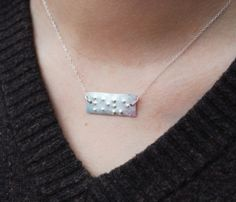 Braille Necklace - I have never seen any braille jewelry before.  This would be a very meaningful gift for someone.
