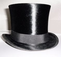 A tall, flat-crowned, cylindrical hat worn by men in the 19th and early 20th centuries, now worn only with morning dress or evening dress