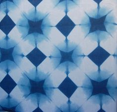 Itajime shibori; is a shaped-resist technique. Traditionally, the cloth is sandwiched between two pieces of wood, which are held in place with string. More modern textile artists can be found using shapes cut from acrylic or plexiglass and holding the shapes with C-clamps. The shapes prevent the dye from penetrating the fabric they cover.  -Putri Hadiarto, FD1A2 -