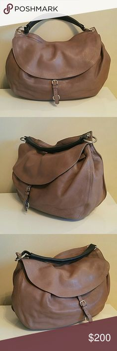 Carlo Pazolini Leather Handbag Soft leather handbag from Carlo Pazolini. Inside is well-organized with 3 divided compartments (middle compartment is zippered) and zippered side pocket. Color is a versatile mauve grey that goes with various outfits and works in all season. Fits over your shoulder  and tucked under your arm. Condition is like new and gently used only a few times. Made in Italy. Carlo Pazolini  Bags Shoulder Bags
