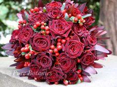 red rose and berry winter wedding bouquet