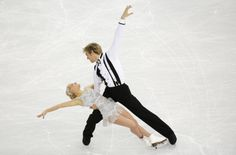Penny Coomes and Nicholas Buckland of Britain compete in the team ice dance short dance figure skating competition at the Iceberg Skating Pa...