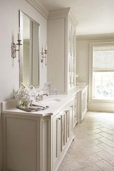 A transitional bathroom in shades of cream, by Linda McDougald Design. Love the pattern of the stone floor!