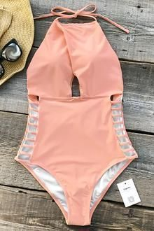 d49b9893a7 Cupshe Gone With the Wind Solid One-piece Swimsuit features halter design  and strappy-details at sides. Solid pink makes it so cute!