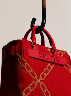 978e85bd1d41 A celebration of  BurberryChineseNewYear The Knitted Belt Bag in bright red  with camel link detailing