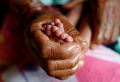 The 25 most powerful photos of 2016 - UNICEF Australia -© UNICEF/UN016487/Shrestha  Nearly a year after the massive earthquake in Nepal, Chinmaya cradled new life in her hands, warming the legs of her newborn grandson.  The grandmother and her family still lived in a temporary shelter at the epicentre of the quake but they had come to UNICEF's shelter home for support. Here, mums and babies can receive food, counselling and medical attention around the clock.