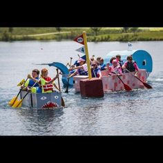 Participants in Metro Parks' 2015 Cardboard Regatta had the challenge of making and sailing their homemade boats made out of cardboard boxes. Racers paddle around the fourth marker before racing back to the dock at the Voice of America Park Saturday, July 18. The Enquirer/Madison Schmidt.