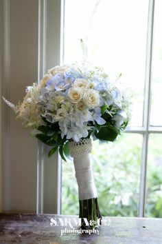 I like this for my bouquet - would swap out the white roses for pale pink, and maybe adjust the greenery. Smaller versions for the bridesmaids.