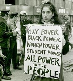 """lgbt-history-archive: """"""""GAY POWER - BLACK POWER - WOMEN POWER - STUDENT POWER - ALL POWER to the PEOPLE,"""" Gay Liberation Front member, New York University, New York City, September 1970. Photo by Diana Davies. @nyplpicturecollection. #lgbthistory..."""