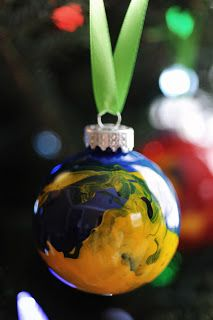 12 Days of DIY Christmas Ornaments - Day 5: Paint Balls All you need is clear plastic bulbs, acrylic or craft paints, small containers for mixing, and tape (preferably painters tape). Baby can help make these!