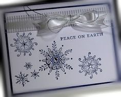 RECIPE:  Stamps:  Serene Snowflakes, Comfort and Joy  Paper:  Night of Navy, Whisper White, Pattern DSP  Ink:  Night of Navy, jelly roll pen  Accessories:  organza ribbon, rhinestones  Tools:  dimensionals