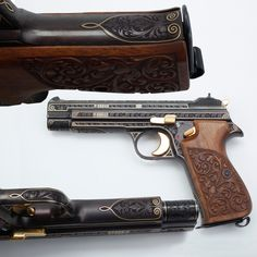 Sig P210 9mm Semi-Automatic Pistol: This pistol presents some of the best repetitive floral engraving curves we've seen recently. It's especially nice to see how the engraver worked with the contours of the receiver to also elegantly highlight and outline features in flowing gold lines.  Even the walnut grip panels on this pistol follow the floral motif repeating on the slide and frame. For those precious metal enthusiasts – the hammer, trigger, slide release & safety lever are all gold-plat...