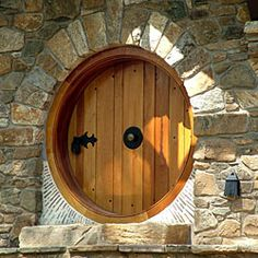 Round Hobbit House door. 3-inch-thick front door is made of Spanish cedar by cabinetmaker David Thorngate of Newark, Delaware.