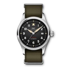 The Pilot's Watch Automatic Spitfire is the first IWC watch to feature an IWC-manufactured movement from the new 32000 calibre family. Top Gun, Iwc Watches, Watches For Men, Stylish Watches, Sport Watches, Smartwatch, Gq, Iwc Chronograph, Accessories