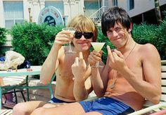 Brian Jones and Keith Richards relax by the pool at the Fort Harrison Hotel in Clearwater, Florida, May 7, 1965.