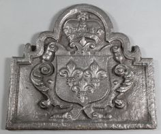 """Lot 239, An arched shaped fireback with coat of arms to the centre 23"""" x 24"""", est £50-75"""