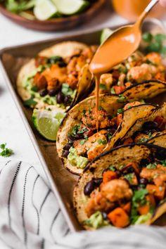roasted sweet potato + cauliflower tacos {vegan, dairy-free} - plays well with butter    #vegan #dairyfree #cauliflower #sweetpotato