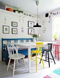 whimsical colorful dining room table bench painted chairs white walls - bench longer than the table
