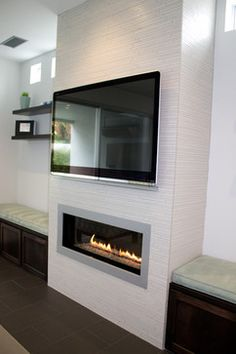 39 Cozy Fireplace Decor Ideas For White Walls A ventless fireplace can go anywhere in your home. Modern Fireplace Decor, Fireplace Tv Wall, Linear Fireplace, Fireplace Remodel, Living Room With Fireplace, Fireplace Surrounds, Fireplace Design, Fireplace Ideas, Fireplace Candles