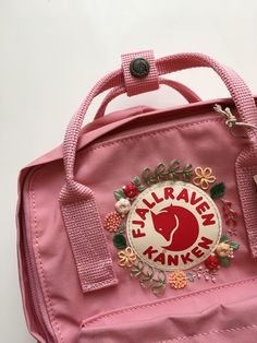 backpacks Customizable Fjallraven Kanken Hand Embroidery Backpack You can choose your favorite color from the Fjallraven Kanken website! The colours in stock may vary from time to time. Mochila Kanken, Mochila Jansport, Embroidery Bags, Cute Embroidery, Pink Kanken, Aesthetic Backpack, Cute Backpacks, Leather Backpacks, Leather Bags