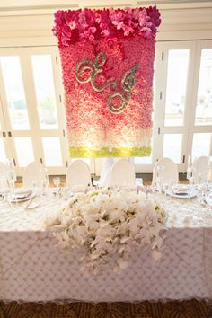 Stunning floral banner as a backdrop for the head table at this beautiful wedding.