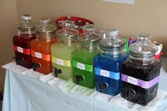I got these beverage dispensers super cheap and put kool aide of each color of the rainbow. Hot glued some ribbon around them and labeled them in the font used for the rest of the party. I set out clear wine like plastic cups so you were able to see the colors. Loved this part of the party.