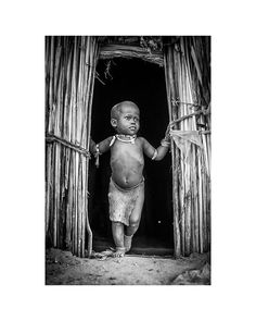 Standing at the entrance to his home the youngest son of a 60 year old Arbore Chief. #Arbore #tribes#Ethiopia#Africaportrait#portrait#home#boy#omovalley#canon_photos#instatravel#travel#natgeo#picoftheday#TravelPics #travel #instatravel #travelgram#portraitoftheday#B&W #passportready #travelblogger #wanderlust #ilovetravel #instatravelling #instavacation#portraitsfromtheworld #streetphotographyinternational#bodyart#bnw#bnwworld