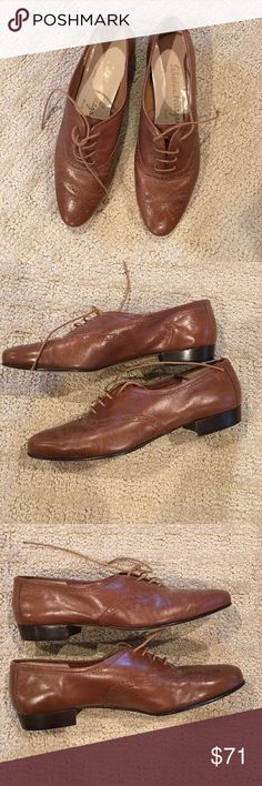 Vintage Salvatore Ferragamo brown oxfords 5 Gorgeous vintage brown leather oxfords with perforated details from Salvatore Ferragamo. Made in Italy. In excellent condition. Leather sole. Size 5B. Like most vintage shoes they are narrower than modern shoes Salvatore Ferragamo Shoes Flats & Loafers