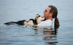 John Unger cradles his 19-year-old dog Schoep to sleep every night in Lake Superior. The cold water and buoyancy help sooth his dog's arthritic pain.