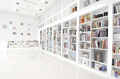 Elegant And Smart Minimalist Design Of Library Room Design Ideas With Large Minimalist Bookshelves And Clean Laminate Flooring Ideas