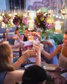Community Garden Party via Martha Stewart. Digging the suspended flowers and candles.