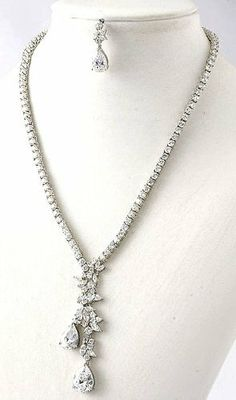 """Beatiful Bridal Jewelry with Prong Set Cubic Zirconia Stones - Brilliant Floral Droplet Occasion Jewelry StarShine Jewelry. $118.00. Approximate length: 27"""". Each CZ stone is individually prong set; not glued.. Lead and Nickel Free. Cubic Zirconias are the closest imitation of diamon in the world. They have perfect clarity and fire.. Comes with matching earrings with clear disc backing for maximum support Prong Set, Bridal Jewelry, Clarity, Jewelry Sets, Stones, Fire, Pendant Necklace, Floral, Earrings"""