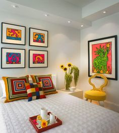 awesome small bedroom with pop art style interior idea along with frame on the wall including white bed cover and flower vase corner and yellow chair