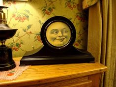 A non-working mantel clock painted black with a moon face!