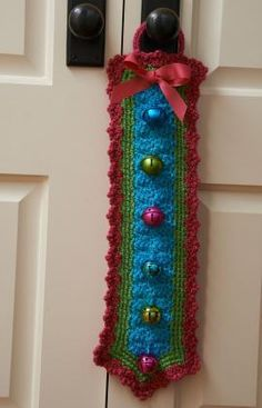 Jingle Bells Door Hanger Free Crochet Pattern from Red Heart Yarns