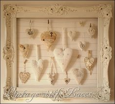 Use old picture frame with wires to hang things. We have a new frame like this at Close to My Heart in the Autumn/Winter 2013 Idea Book, but not as fancy. Could paint old frames white and do it this way too.