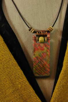 https://flic.kr/p/hfbxRY | Tiger stripes - around neck | This bold...and a little wild... polymer clay pendant is 1 x 3.5 inches. I used horn and ceramic beads for accent. It hangs from a 2mm brown leather cord. The pendant is made using a cracked silver foil technique with alcohol inks. The pendant is slightly curved that I baked over a flask! www.etsy.com/listing/167946039/tiger-stripes-polymer-clay...