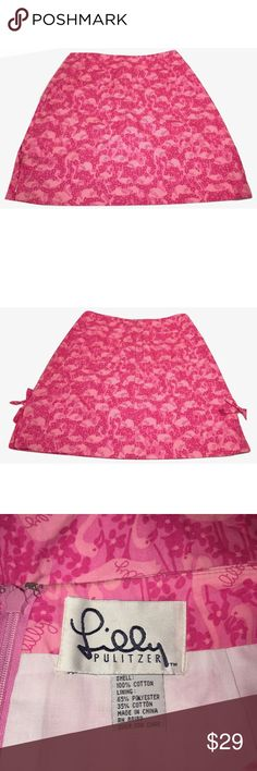 """Lilly Pulitzer Sz S Flamingo Pink Skirt EUC Lilly Pulitzer Sz S Flamingo Pink Skirt EUC🔸Size Small-Size tag missing, waist measures 15"""" across🔸Length 19""""🔸 Hips 20""""🔸Back zip with two back pockets🔸Cute small side bows on the bottom🔸Lined🔸Cotton/Polyester material🔸Pre owned has been washed and worn-EUC Lilly Pulitzer Skirts"""