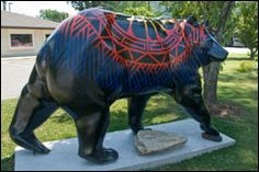 """Take pictures with all the Cherokee Bears!: The Bears of Cherokee: Downtown Cherokee is """"alive"""" with colorfully painted fiberglass bears that are part of a public art program featuring the talents of local Tribal artists. Each one of the bears represents an aspect of Cherokee culture. You'll find """"Eagle Dancer Bear,"""" """"Woodlands Pottery Bear,"""" """"Winter Bear,"""" """"Fish Bear,"""" and even """"Veterans' Bear."""""""