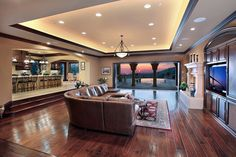 Love the ceiling and the step down into the living room. I wouldn't want so much empty space though. Would want it closer to the kitchen and possibly lower the ceiling.