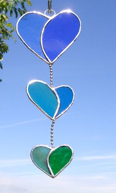 Three colourful hearts strung together. Any color combination can be made, just request your preference. Large heart measures 3.5x 3.5, the middle
