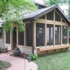 Sometimes it's the small details that make a big difference. Notice the built-in flower box on this screened porch.