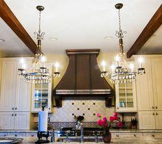 Lighting design: Eileen Naughton. Private Home in Clifton, Virginia. Kitchen Island.