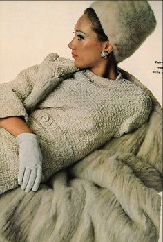 1965 Marisa in a chunky tweed oatmeal dress with matching coat lined in mink by Ben Reig, mink hat by Emme, earrings by Mimi di N, photo by Penn, Vogue US