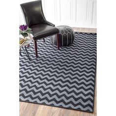 $179.99 Soft and plush, the pile on this contemporary area rug is made from polypropylene to prevent shedding, and makes a fun addition to any fashionable space.  Add a sense of texture to a modern living room with this attractive rug.