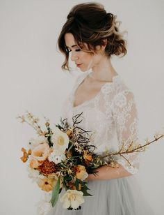 Mignonette Bridal Atelier Dress // moody spring bouquet with poppies and pops of orange and cream